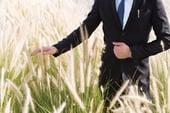 Man touching grass